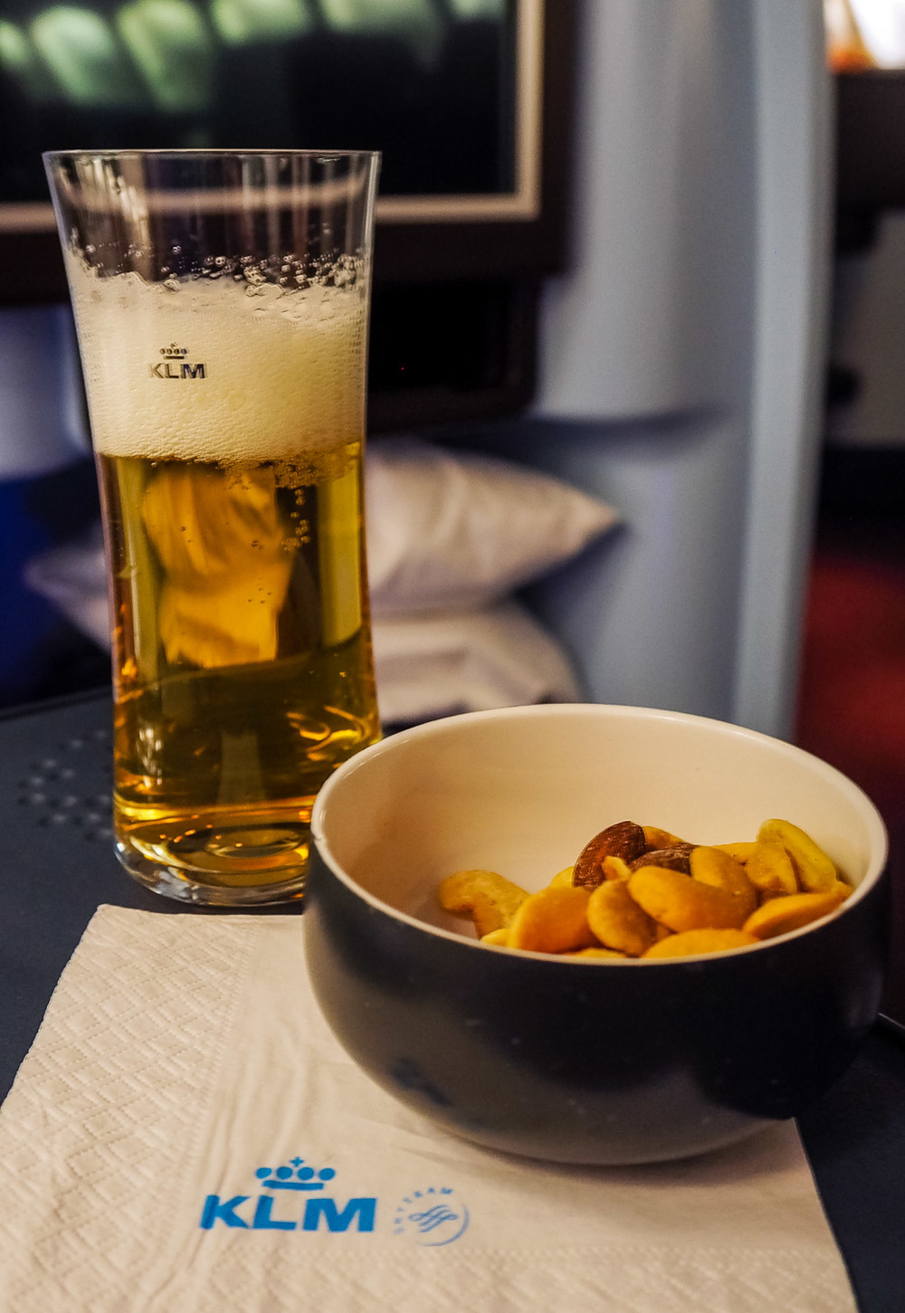 Mixed nuts & beer - KLM Business Class - by Britney Hope - The Wayward Post