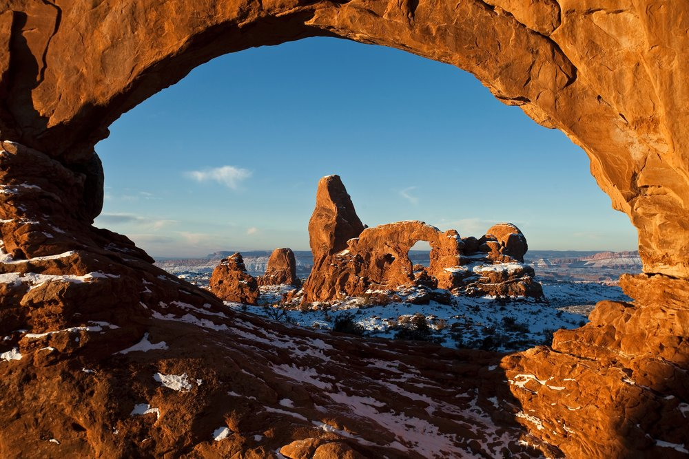 First Light on Turret Arch Framed by North Window - Photo Credit: NPS/Jacob W. Frank