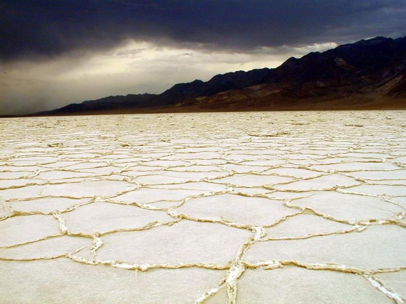 A stormy backdrop at the Badwater Salt Flats in Death Valley National Park Credit-NPS