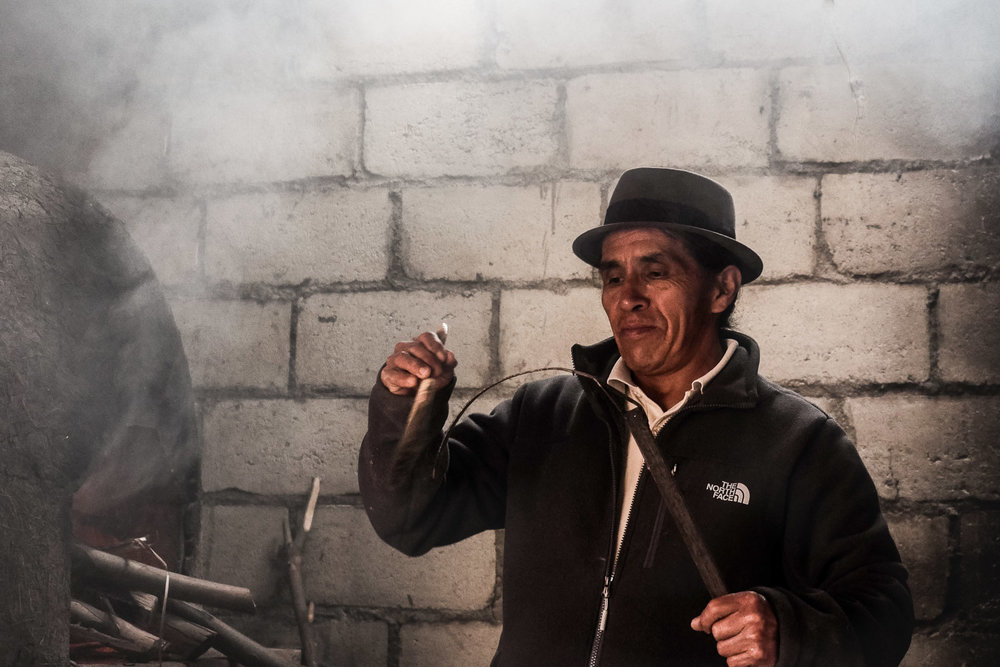 Man by wood oven. Faces of the Worlds Richest People, Ecuador - The Wayward Post