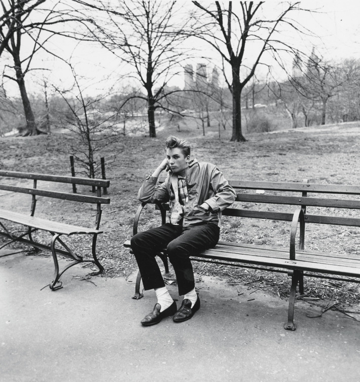 Teenage boy on a bench in Central Park, N.Y.C. 1962