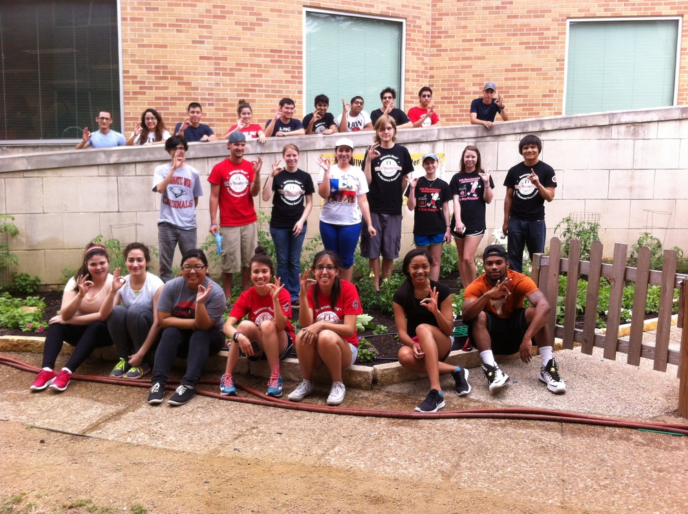 UIW Students working the community garden