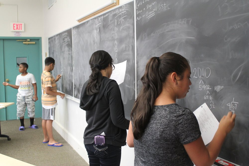A number of students work diligently on problem sets in their Math Team Strategies class, which reviews techniques for quick in easy problem solving in the face of seemingly difficult questions. Mathematicians can be a lazy bunch, so learning the techniques to making challenging problems easier is an important skill set!