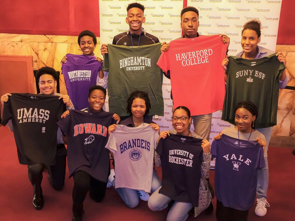 And now: Aisha, Malachi, Will, Vielka, Henry, Eli, Ariel, Tanasia, and Aishat proudly show off their college t-shirts.