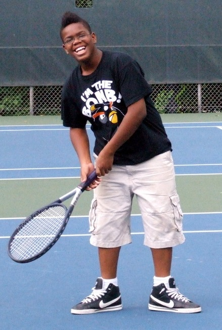 Zavier plays tennis at BEAM 7 in 2011.