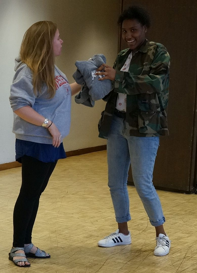 Vielka receives her SUNY ESF sweatshirt.