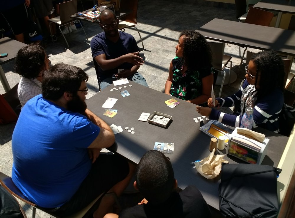 Kathy plays Coup with staff Don, Claire, and Ayinde as well as students Jade and Andrew