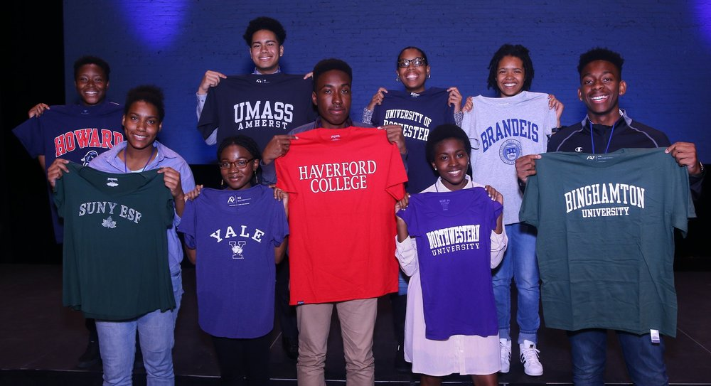 BEAM students announce their college plans at College Decision Day at the Apollo Theater, May 2018.  Back row: Elijah (Howard), Henry (UMass Amherst), Tanasia (Rochester), Ariel (Brandeis)  Front row: Vielka (SUNY ESF), Aishat (Yale), Will (Haverford), Aisha (Northwestern), Malachi (SUNY Binghamton)