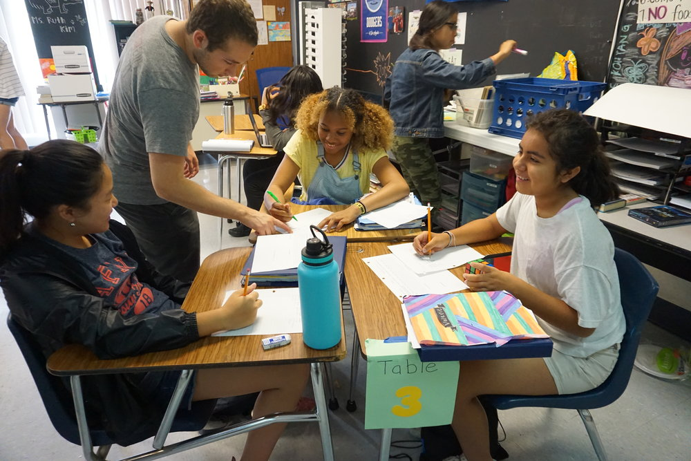 From left to right, Sharon, Daniel, Rihighna, and Valerie work on problem sets during OMT.
