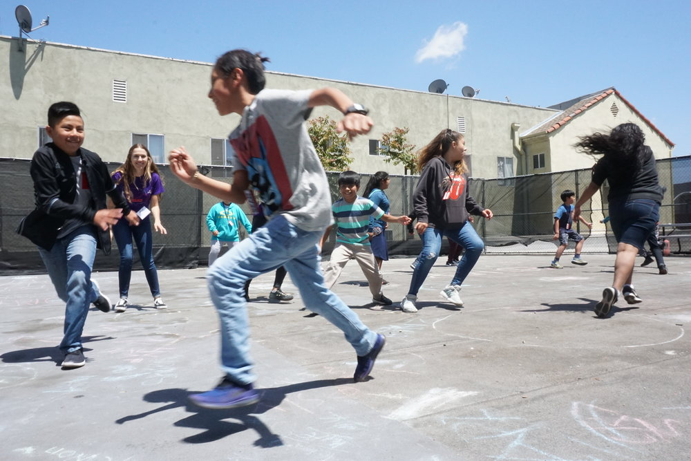 Students and counselors take a break to play tag at non-residential program BEAM 6 in Los Angeles.