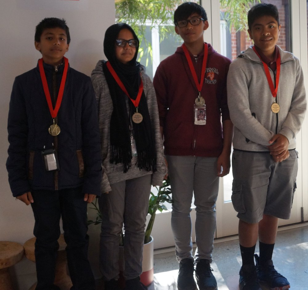 From left to right, Adib, Mayisa, M.K. Luis, and Kevin won first place in the team round representing Virgil Middle School.
