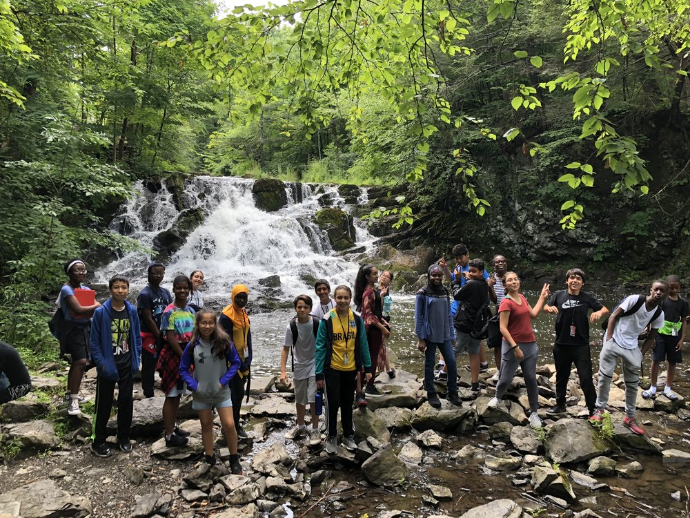 Students at BEAM Summer Away 2018 explore a waterfall together!