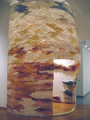 Hunk and Dora, 2006, abaca, cotton, linen, wood monofilament, tyvek, buttons, sand, 14' tower, 6' doorway, Columbia College