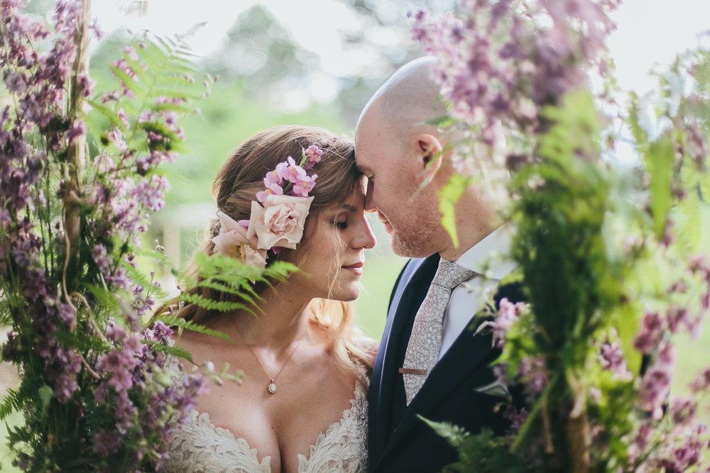 Color Fields Spring Wedding Flowers Swing Couple.jpg