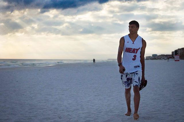 Triathlete @lucian_r3 beach strut at sundown