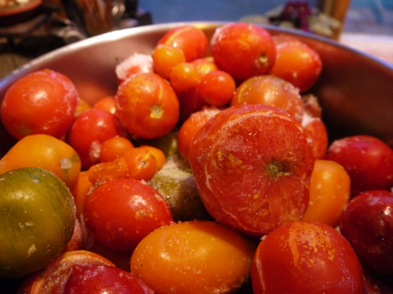 Just dump the frozen tomatoes into a stock pot and begin cooking.