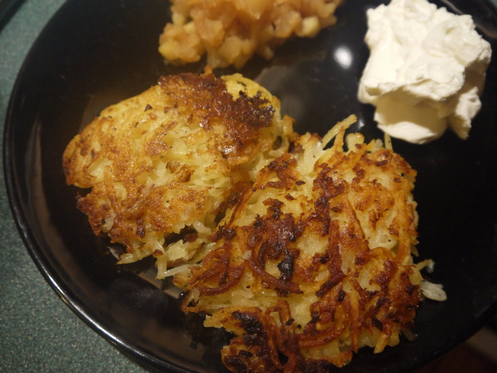 The perfect latke is crisp, not greasy, is golden brown on the outside and snowy white inside.