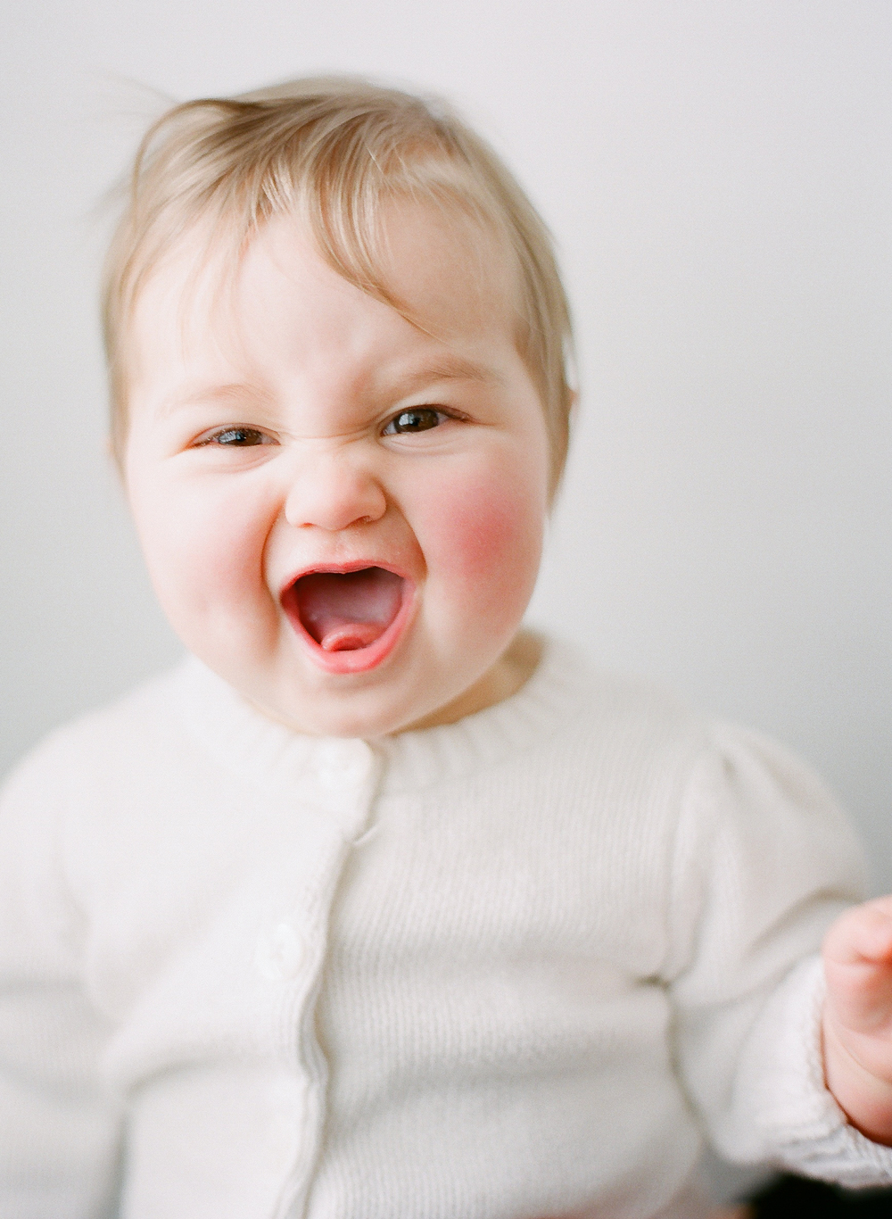 Baby photography Seattle, by Sandra Coan. Studio photograph. Baby laughing