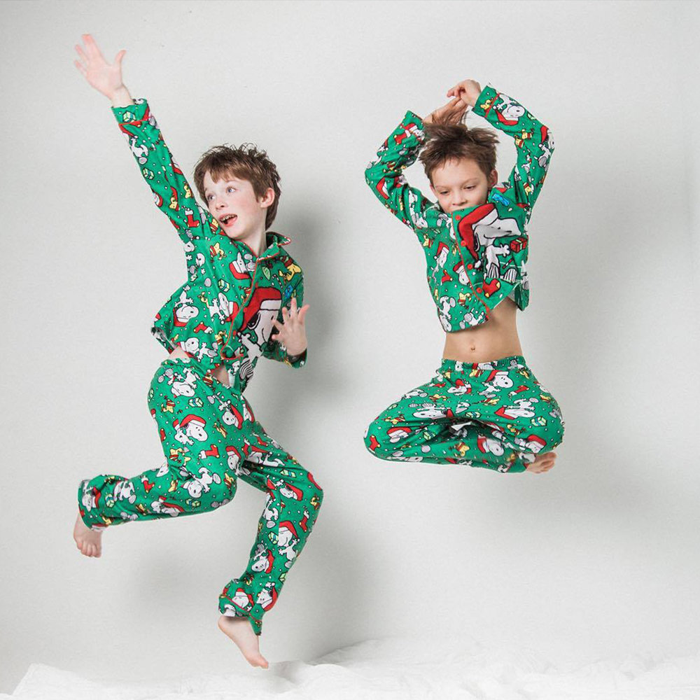 Brothers jumping in matching holiday outfits in Seattle mini sessions