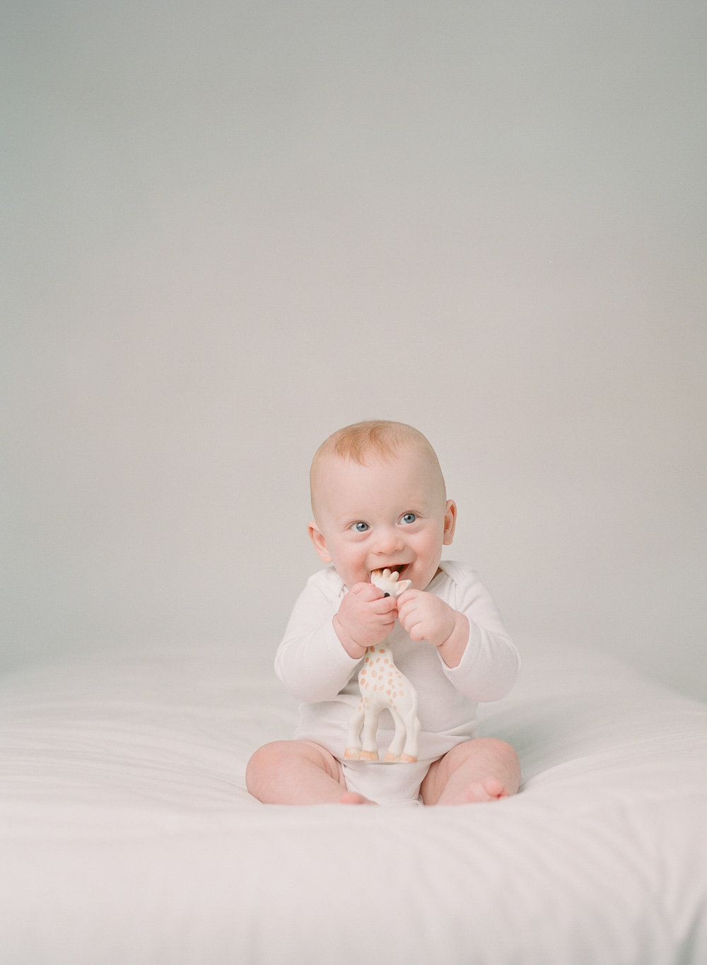 Newborn photographer Seattle | Sandra Coan | baby with giraffe toy photographed on film