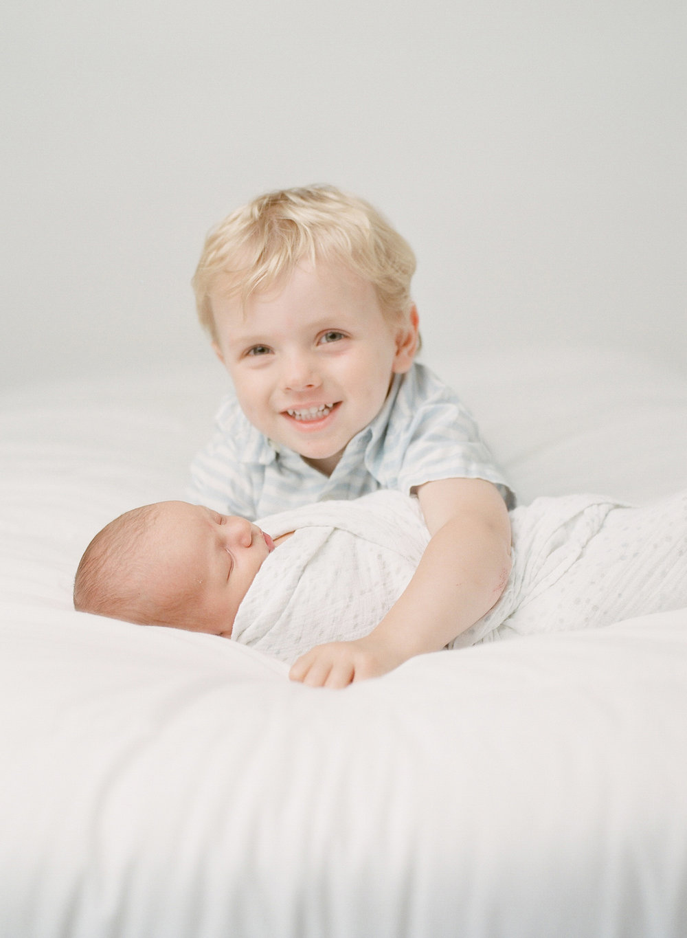 Newborn photographer Seattle | Sandra Coan | Baby and brother photographed on film