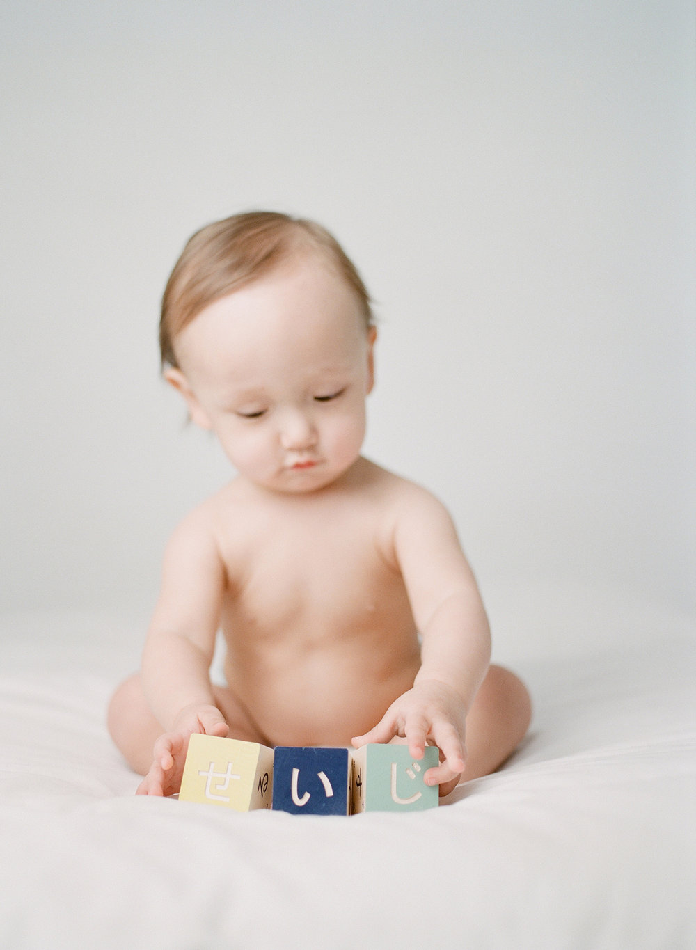what to bring to a photography studio | bringing props and toys to your studio session | first birthday japanese character blocks | film photographer sandra coan