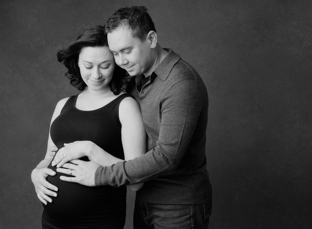 Seattle Maternity Photography Sandra Coan Black and White maternity image of a couple together in studio
