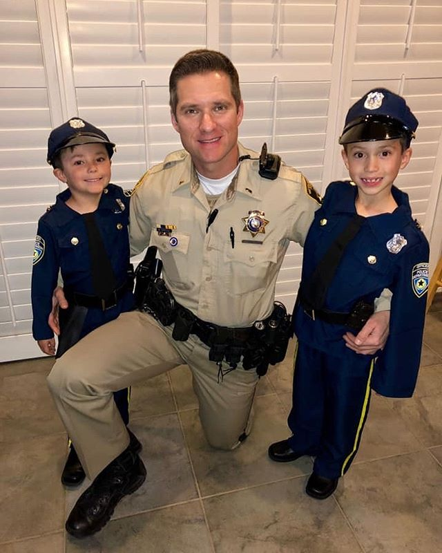 "Today is ""Community Superhero"" day at school. Of course these cute boys had to dress up like daddy...their number one hero!!💙👮‍♂️💙 #lvmpd #humanizethebadge"