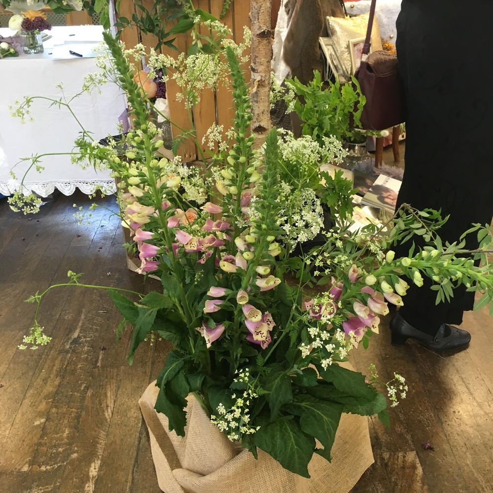 Foxgloves and cow parsley create a wild meadow feel