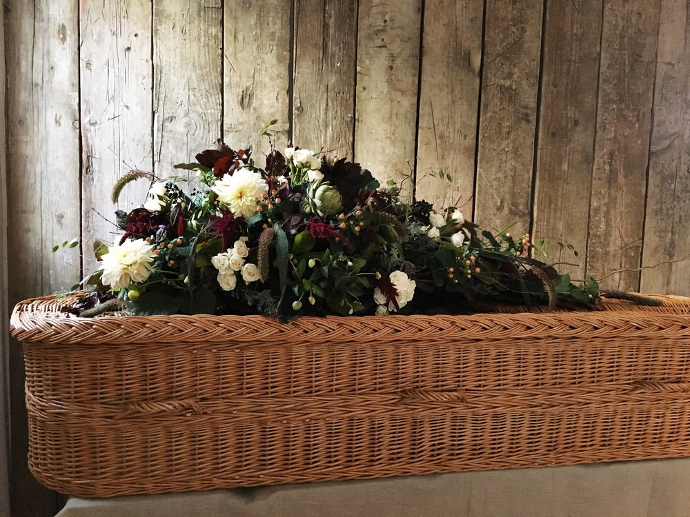 A seasonal, wild single-ended coffin spray for a natural funeral, by Bloomologie, Blackheath