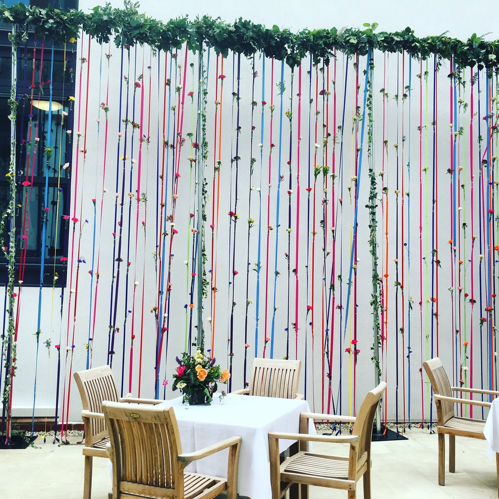 Bloomologie events florist London flower wall