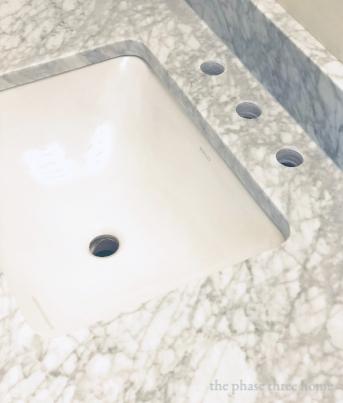 carrara marble vanity