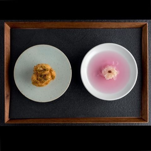 "Happy New Year! We can't wait to share what we have in store for you. Here's a peek - crispy cod milt with sansho berry and sansho leaf served with ""dongchimi"" kohlrabi in chrysanthemum, aloe vera and mustard. 새해 복 많이 받으세요! Photo by @porkbellystudio"