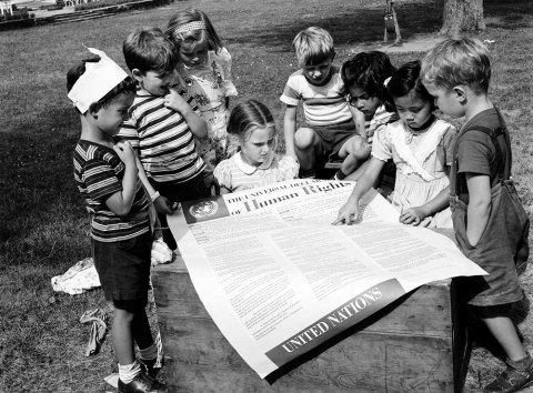 In 1950, on the second anniversary of the adoption of the Universal Declaration of Human Rights, students at the UN International Nursery School in New York viewed a poster of the historic document. (UN photo)