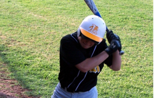 a baseball player waits for a pitch.
