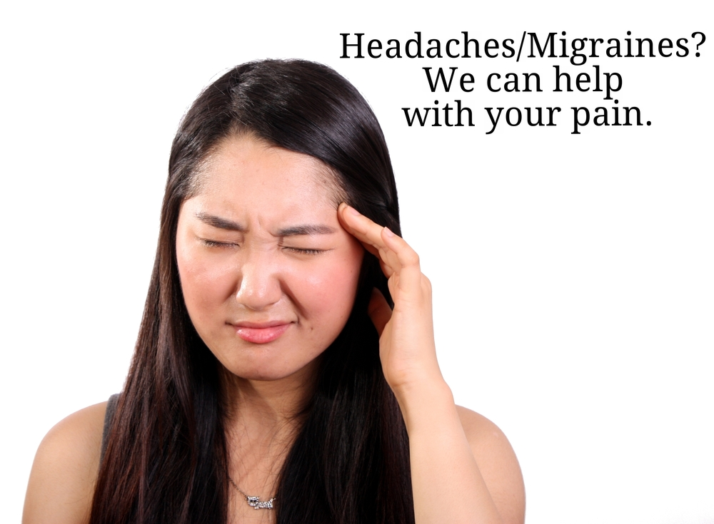 Headaches/migraines? We can help with your pain (A woman rubs her temple).
