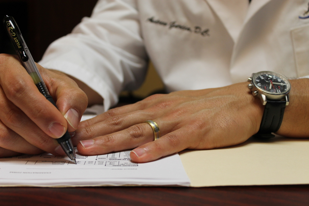 Dr. Garcia writes in a patient chart.