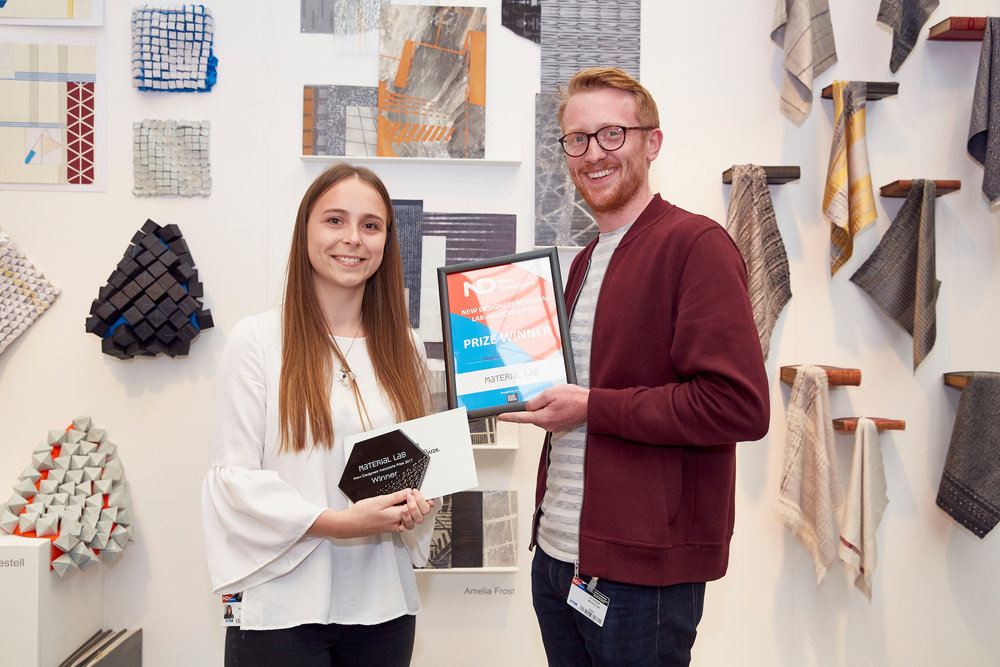 Amelia Frost accepting her Associate Prize from Jim Biddulph of Material Lab