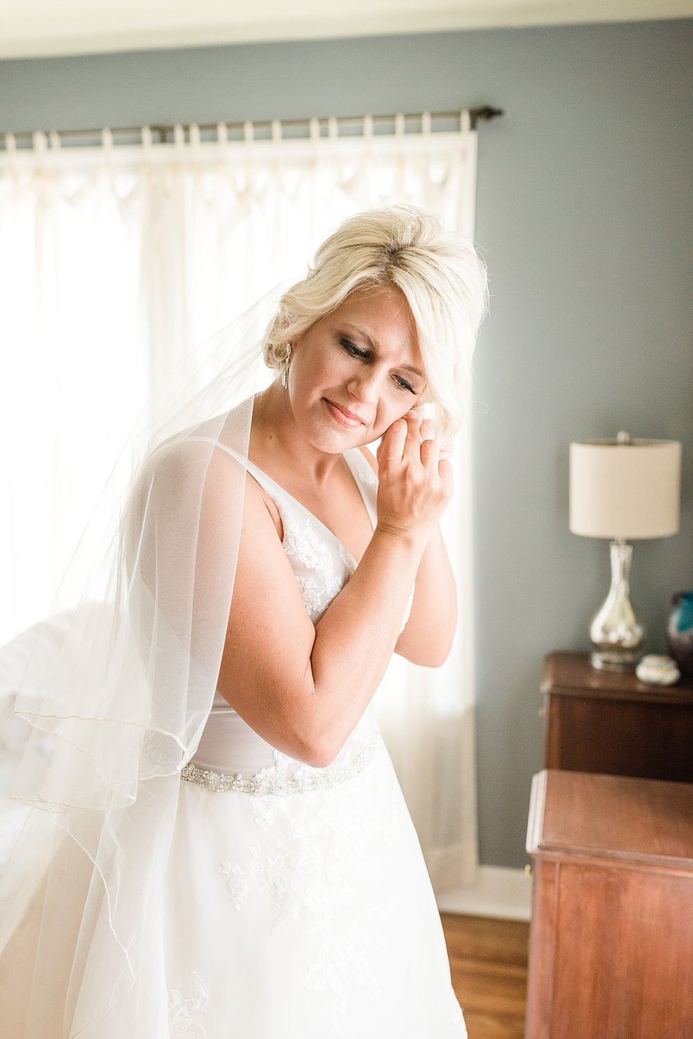 Rose Gold, White, and Greenery High Class Summer Wedding at The Millbottom in Downtown Jefferson City by Kelsi Kliethermes Photography_0013.jpg