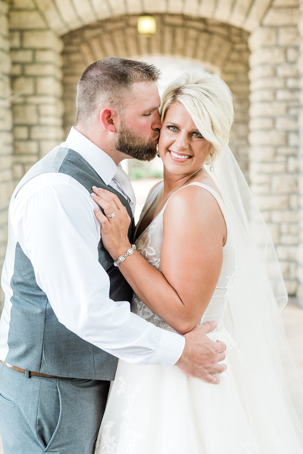 Rose Gold, White, and Greenery High Class Summer Wedding at The Millbottom in Downtown Jefferson City by Kelsi Kliethermes Photography_0021.jpg