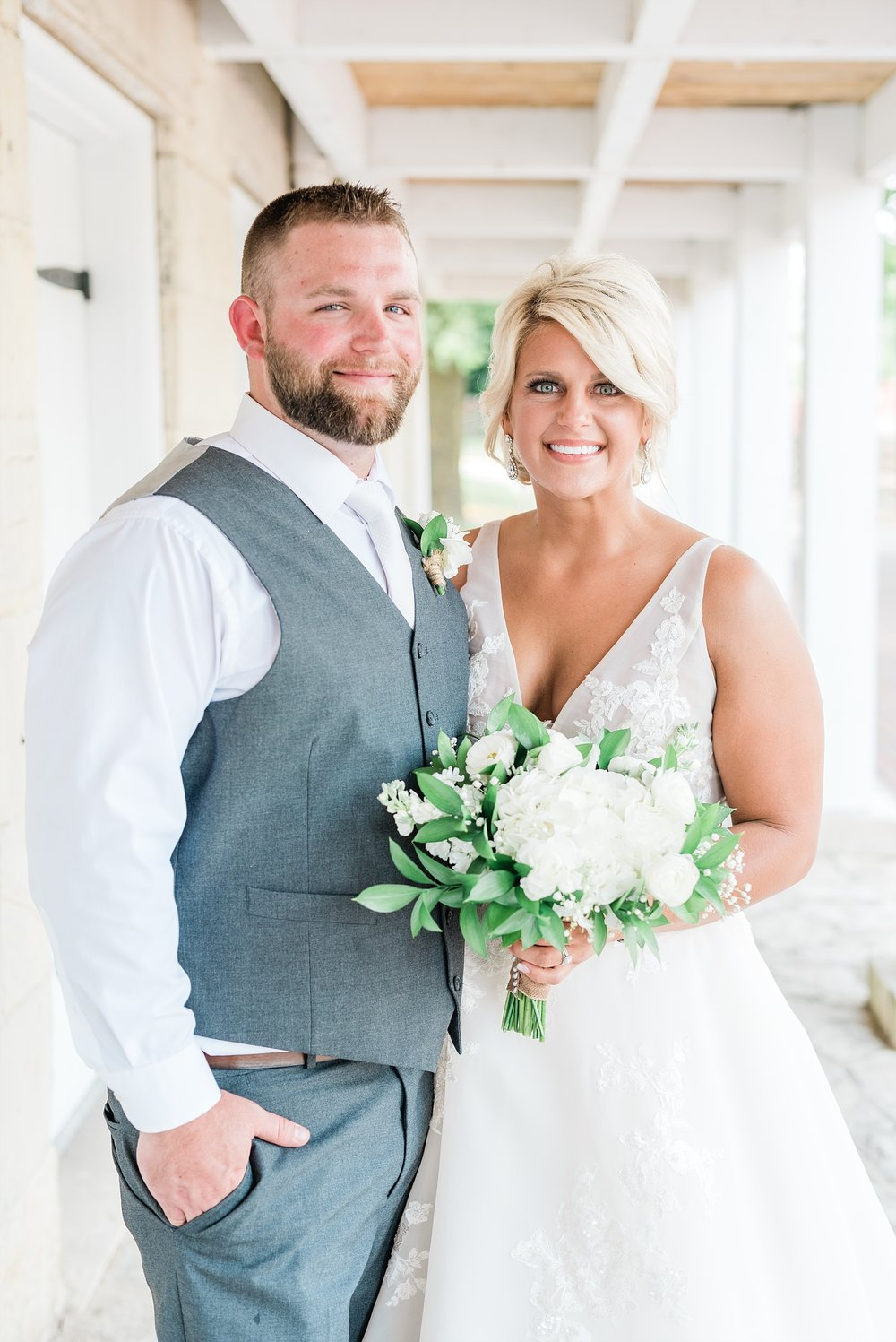 Rose Gold, White, and Greenery High Class Summer Wedding at The Millbottom in Downtown Jefferson City by Kelsi Kliethermes Photography_0026.jpg
