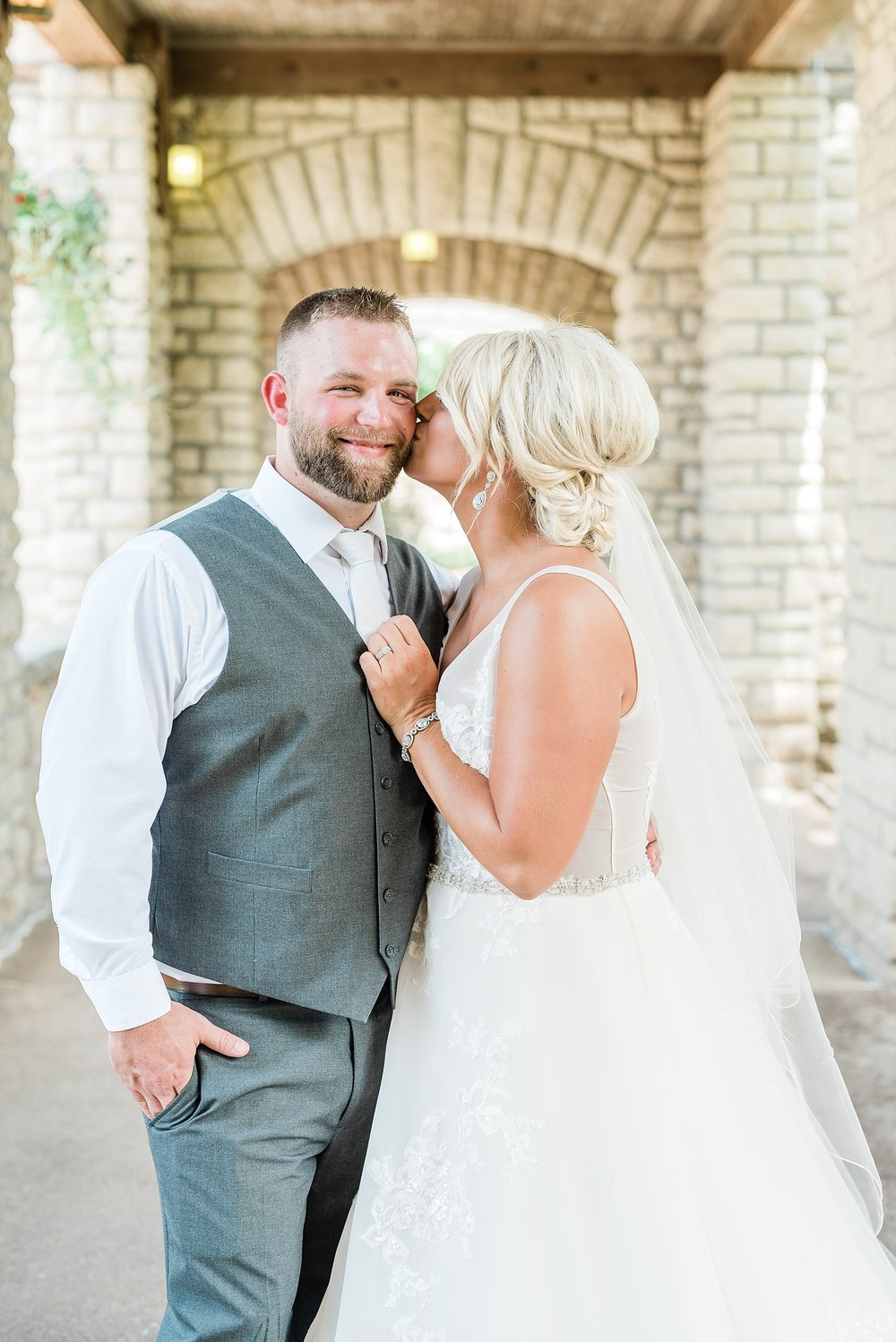 Rose Gold, White, and Greenery High Class Summer Wedding at The Millbottom in Downtown Jefferson City by Kelsi Kliethermes Photography_0025.jpg
