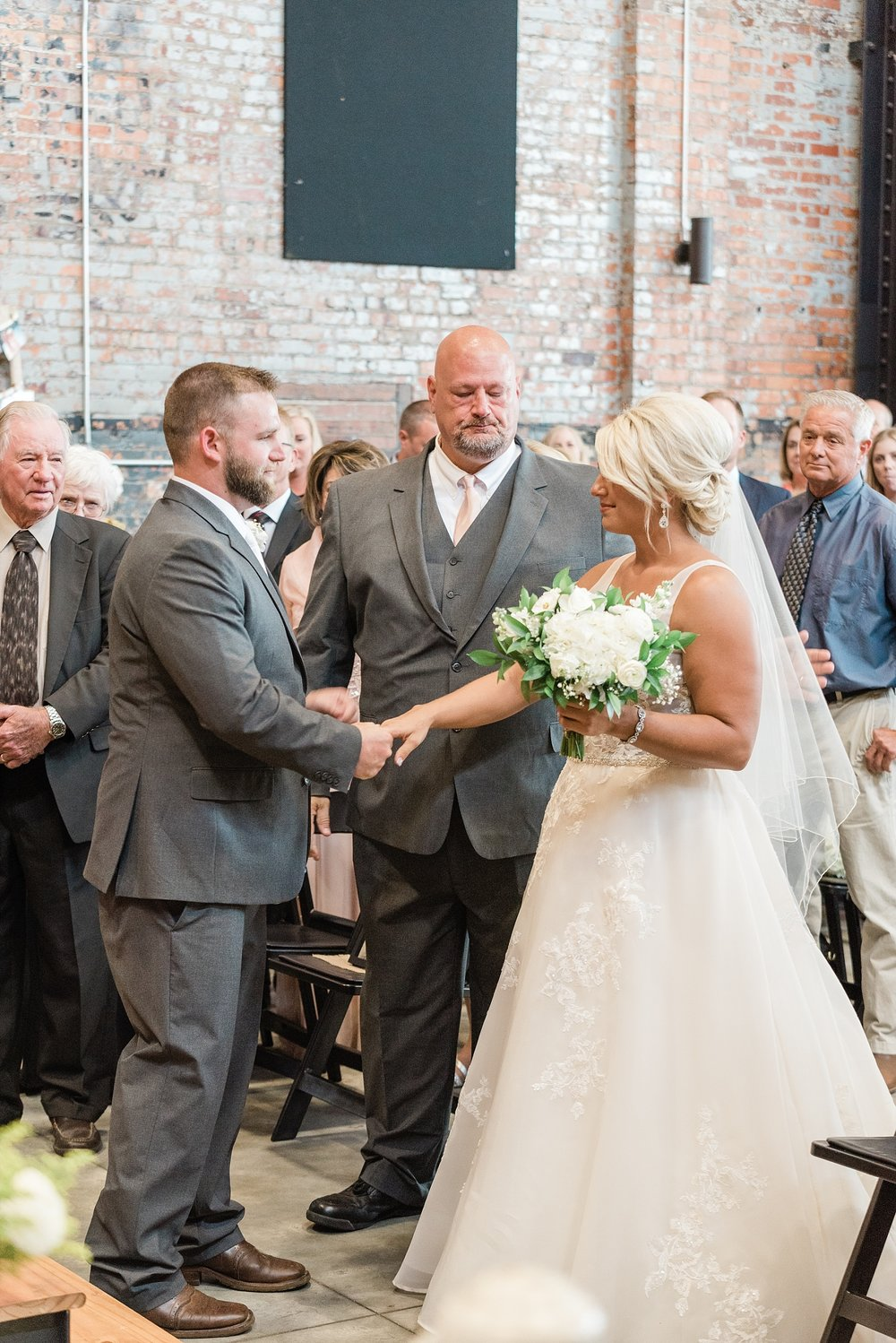 Rose Gold, White, and Greenery High Class Summer Wedding at The Millbottom in Downtown Jefferson City by Kelsi Kliethermes Photography_0039.jpg