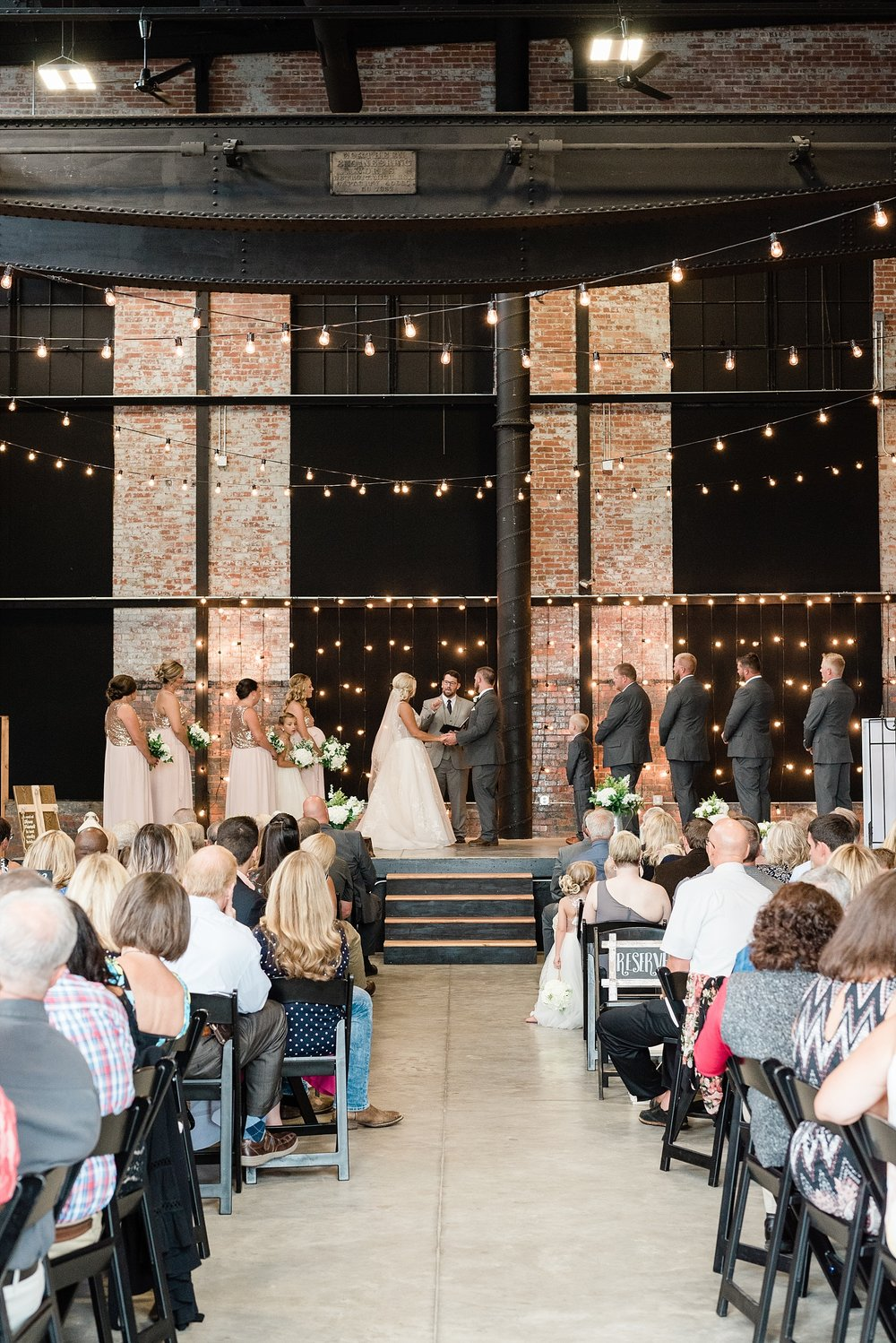Rose Gold, White, and Greenery High Class Summer Wedding at The Millbottom in Downtown Jefferson City by Kelsi Kliethermes Photography_0040.jpg