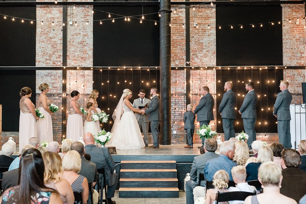 Rose Gold, White, and Greenery High Class Summer Wedding at The Millbottom in Downtown Jefferson City by Kelsi Kliethermes Photography_0041.jpg