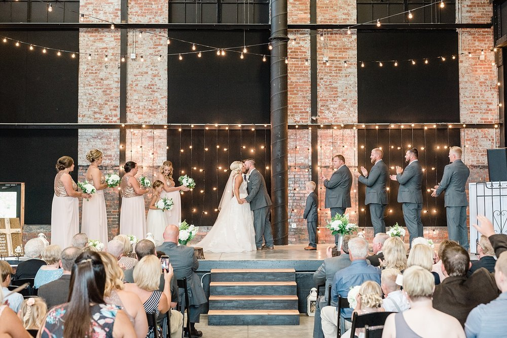 Rose Gold, White, and Greenery High Class Summer Wedding at The Millbottom in Downtown Jefferson City by Kelsi Kliethermes Photography_0045.jpg