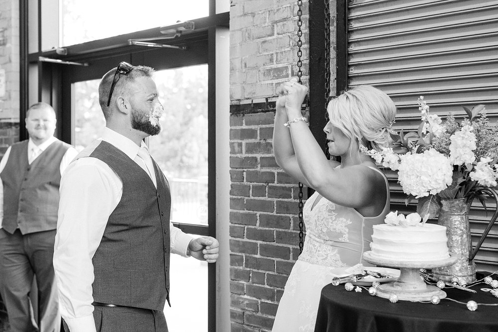 Rose Gold, White, and Greenery High Class Summer Wedding at The Millbottom in Downtown Jefferson City by Kelsi Kliethermes Photography_0048.jpg