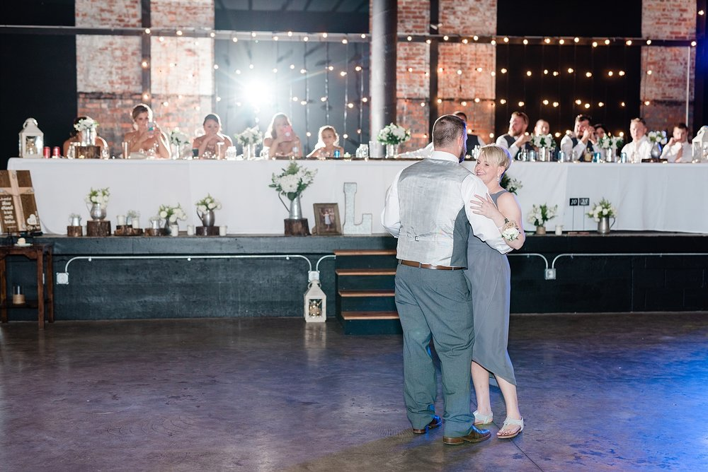 Rose Gold, White, and Greenery High Class Summer Wedding at The Millbottom in Downtown Jefferson City by Kelsi Kliethermes Photography_0054.jpg