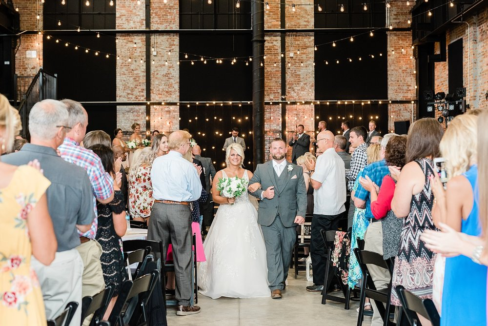Rose Gold, White, and Greenery High Class Summer Wedding at The Millbottom in Downtown Jefferson City by Kelsi Kliethermes Photography_0055.jpg