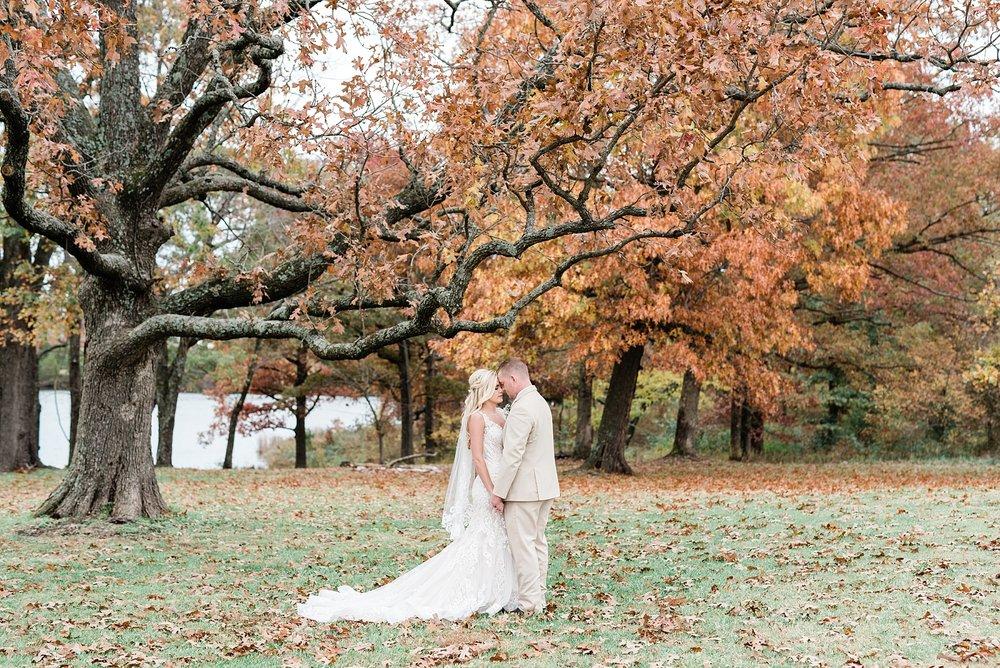 newly weds at fall wedding at mighty oak lodge missouri